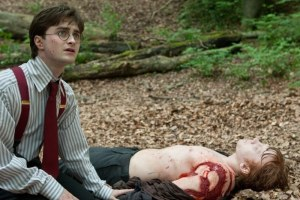 Rupert Grint as Ron lies injured after a close encounter in 'Harry Potter and the Deathly Hallows Part 1' - Source